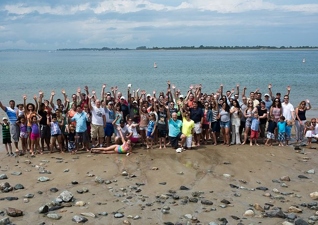 group photo of people at the beach