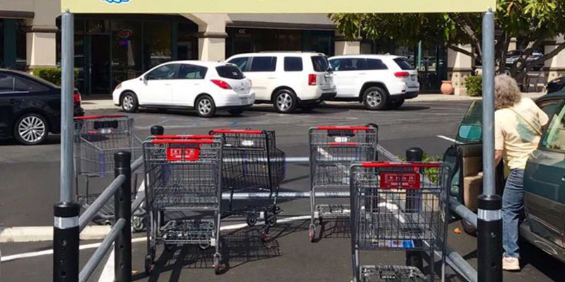 McCue Cart Corral with signage in Parking Lot